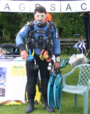 A fully equipped diver, all that is missing is somewhere to dive.