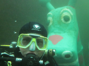 Diver and creature posing for the camera